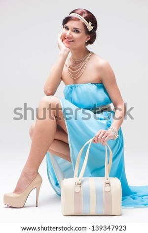 Girl in blue evening dress - stock photo