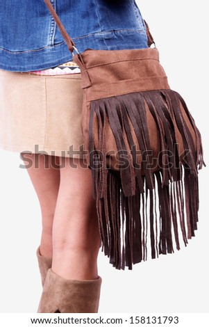 girl in boots, wearing modern purse, clipping path - stock photo