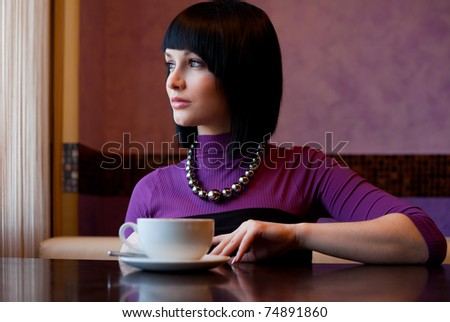 girl in cafe look at window - stock photo