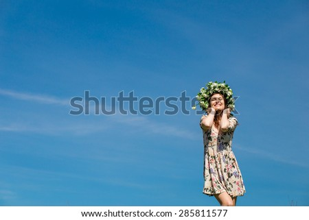 girl in colorful dress enjoying life in wheat meadow in summer - stock photo