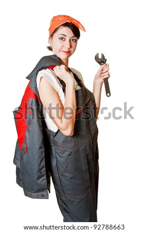 Girl in coveralls with spanner isolated on white background - stock photo