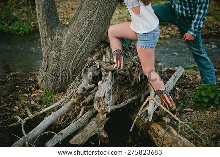Girl in cowboy boots - stock photo
