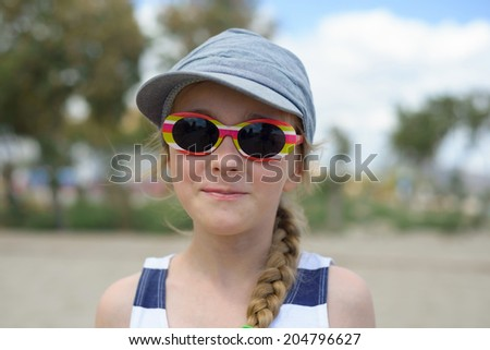 Girl in denim hat and sunglasses - stock photo