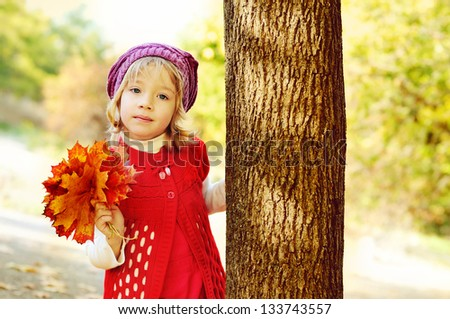girl in fall with bouquet of leaves - stock photo