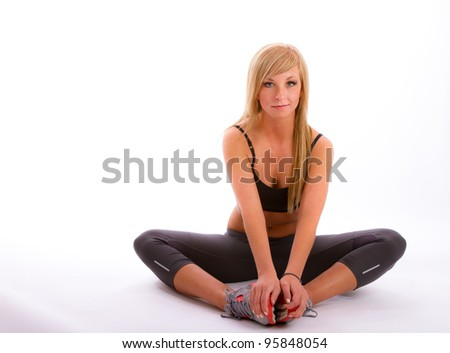 Girl in fitness attire doing various stretches - stock photo