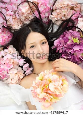 Girl in flower sakura japanese style - stock photo