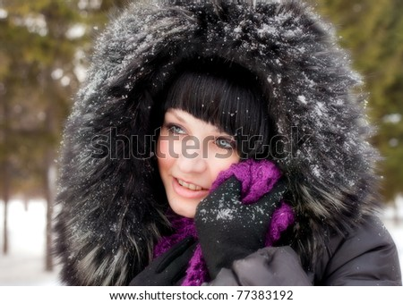 girl in fur hood and snow - stock photo