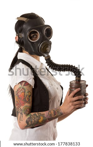 girl in gas mask with tattoos - stock photo