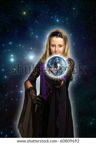 girl in gothic dress holding planet earth over a space background - stock photo