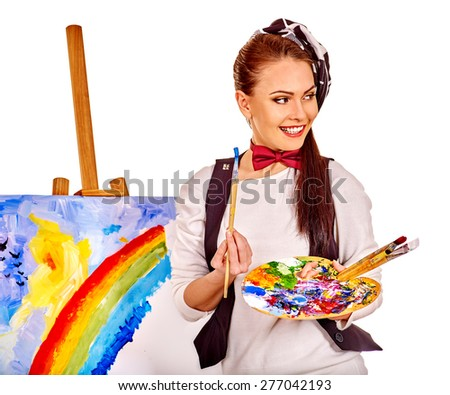 Girl in hat holding hands on background of easel. Isolated on white. - stock photo