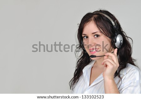 Girl in headphones answer the call - stock photo
