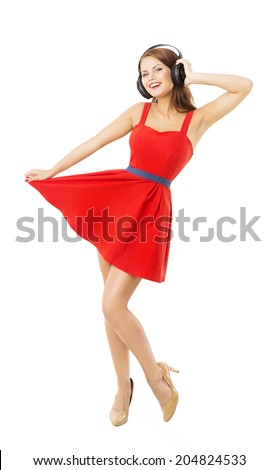Girl in headphones dancing listening to music. Woman portrait over white background  - stock photo