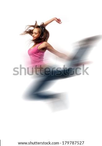 girl in headphones jumps over the floor of happiness - stock photo