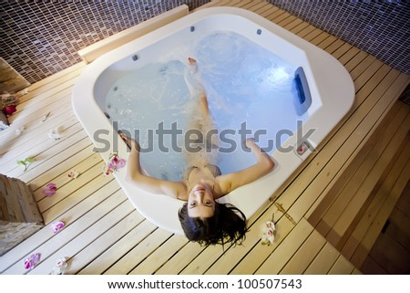 Girl in hot tub - stock photo
