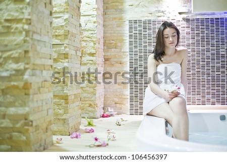 Girl in hot tub - stock photo