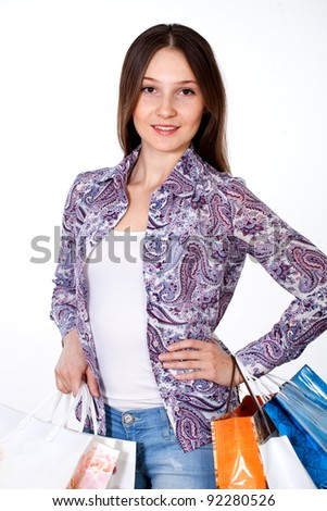 girl in hurry to sell at  clothing store - stock photo