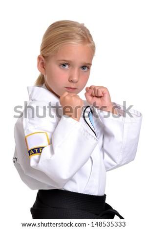 girl in karate uniform white background - stock photo