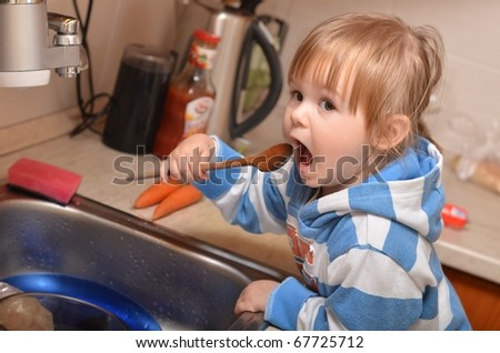 girl in kitchen - stock photo