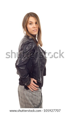 Girl in leather jacket - Young fashion model posing in a black leather jacket on white background - stock photo