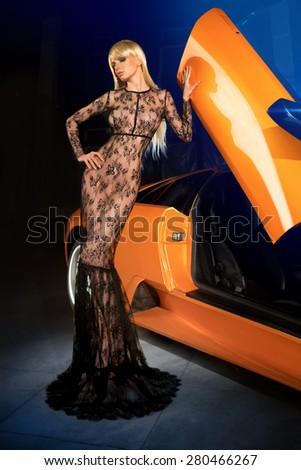 Girl in lingerie near car - stock photo