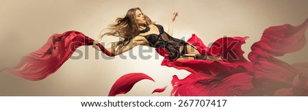 Girl in lingerie takes off from the fabric, as if from a flower - stock photo