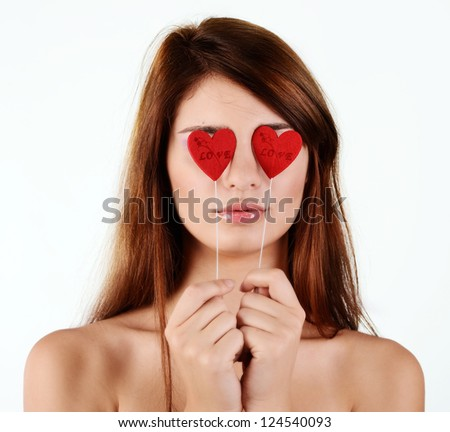 girl in love with hearts near the eyes - stock photo