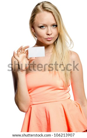 girl in pink shows white card - stock photo