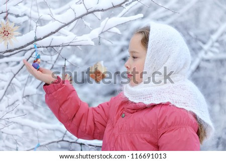 girl in profile. Winter nature and a lot of snow. On the baby shawl. Christmas spirit - stock photo