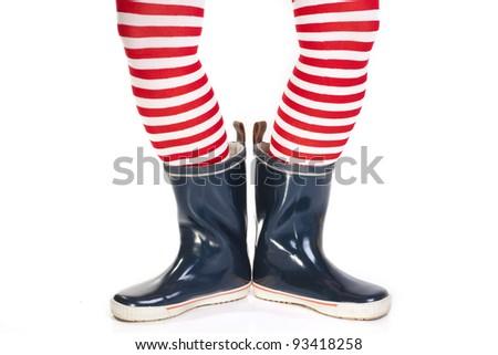 Girl in rain boots - stock photo
