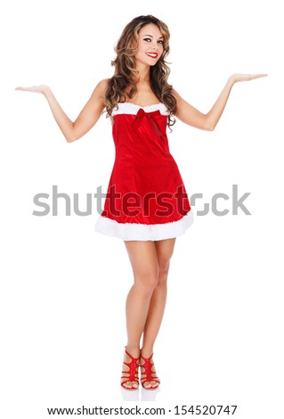 Girl in red dress shows something on her hands  - stock photo
