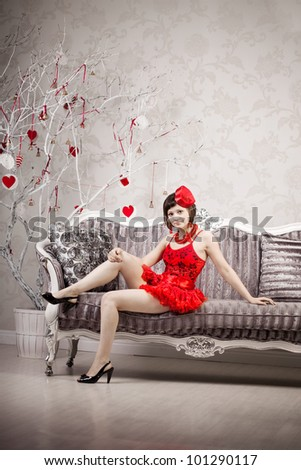 Girl in red on a luxury background - stock photo
