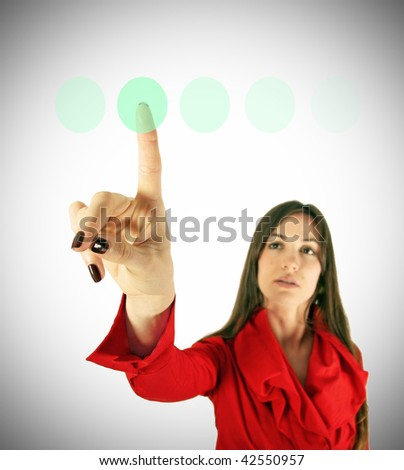 Girl in red touch virtual green button finger. Modern technology concept. Business concept. - stock photo