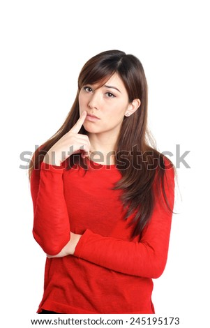 Girl in red with thinking hand gesture on white background - stock photo