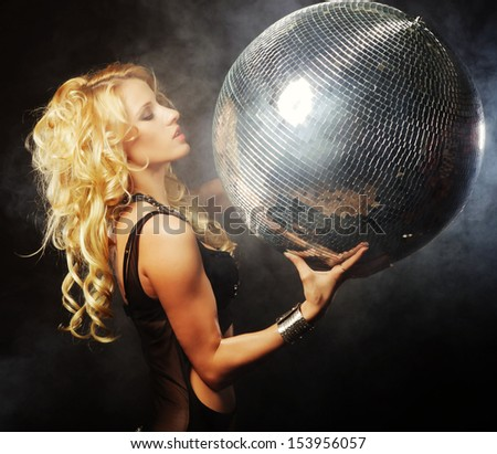 girl in smoke with disco ball - stock photo