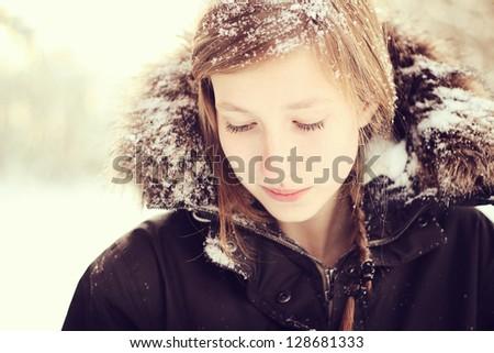 Girl in snow - stock photo