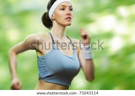 girl in sport on the nature - stock photo