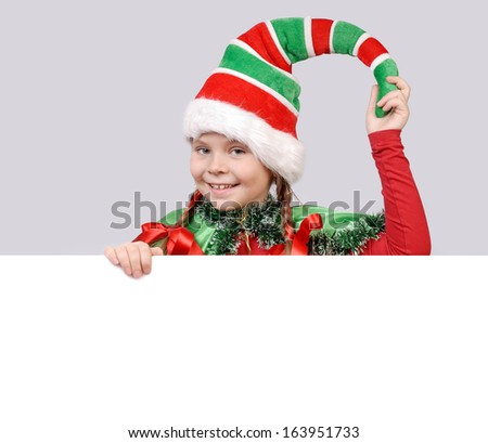 Girl in suit of Christmas elf with the white board - stock photo