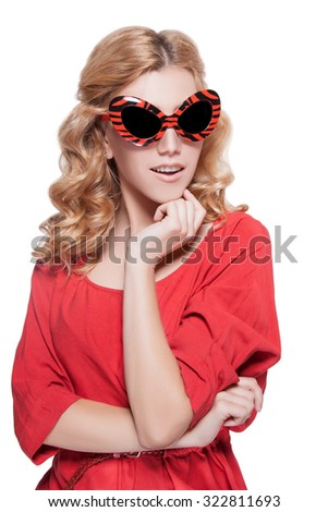 Girl in sunglasses.Blond woman isolated on a white background in a red dress and sunglasses.Cheerful woman with red sunglasses with his mouth open,white teeth.mouth open.Beautiful woman in a red dress - stock photo