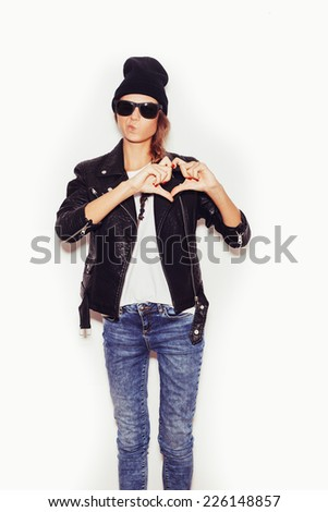 Girl in sunglasses Forming a Heart with Her Hands.  White background, toned, not isolated - stock photo