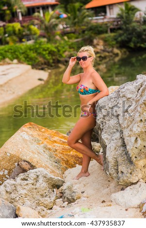 girl in sunglasses looking into the distance on the ocean - stock photo