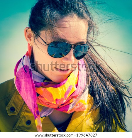 girl in sunglasses with a scarf on a neck - stock photo
