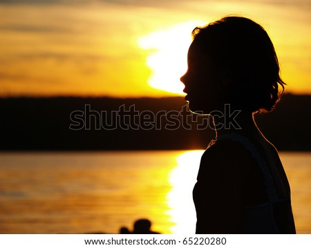 Girl in sunset - stock photo