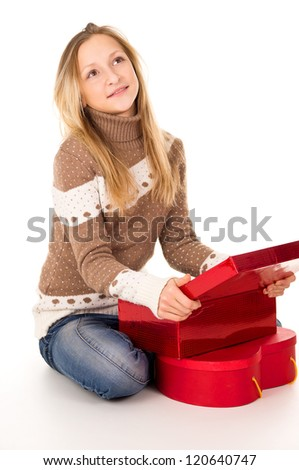girl in sweater sitting with gifts - stock photo