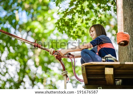 Girl in the adventure park - stock photo