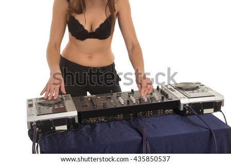 Girl in the black bra is playing with the mixer - stock photo