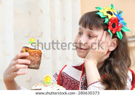 girl in the embroidered shirt with Easter egg - stock photo