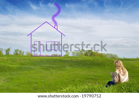 Girl in the field dreams about the house - stock photo