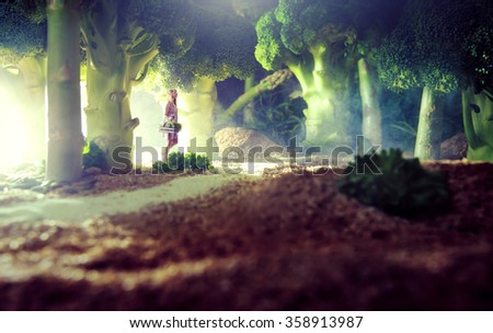 Girl in the food forest  - stock photo