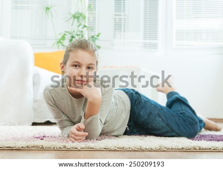 Girl in the living room - stock photo