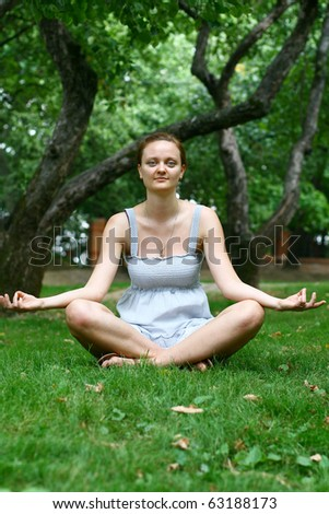 girl In the lotus posture - stock photo
